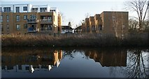 TQ1479 : View of the Deck Court apartments reflected in the Grand Union Canal near Three Bridges by Robert Lamb