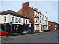 NZ6025 : Business and houses on Station Road, Redcar by JThomas