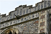TL8866 : Great Barton: Holy Innocents Church: Fine flushwork in the south face of the tower by Michael Garlick