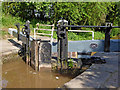 SJ6542 : Lock gates on the Audlem flight in Cheshire by Roger  Kidd