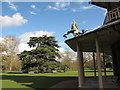 TQ1876 : View to trees past pagoda with dragon, Kew Gardens by David Hawgood