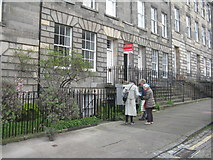 NT2574 : Scotland Street's Little Free Library in use by M J Richardson