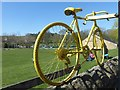 SK2692 : Yellow bike on a wall by Graham Hogg