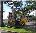 ST2991 : Yellow JCB parked near Malpas Court Mansion House, Newport by Jaggery