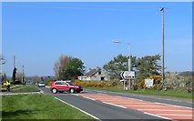 J3633 : Traffic joining the A50 (Castlewellan/Newcastle Road) from the B180 (Ballyhafry Road) by Eric Jones