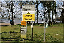 NX6548 : Signs at Nun Mill Bay by Billy McCrorie