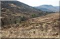 NN1187 : Moorland slope descending to River Mallie by Trevor Littlewood