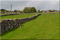 SK1678 : Stone-walled fields sloping up to Little Hucklow by David Martin