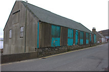 HU4039 : Harbour shed on Main St, Scalloway by Robert Eva