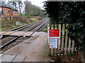 SJ3165 : Bilingual notices on the approach to  Hawarden railway station level crossing, Flintshire by Jaggery