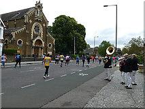TQ4077 : Brass band encouraging marathon runners by Stephen Craven