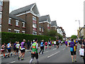 TQ3778 : Runners on West Ferry Road by Stephen Craven