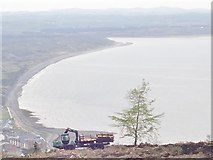 J3629 : John Deere forestry equipment in operation against the background of Dundrum Bay by Eric Jones