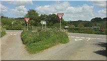 SS5726 : Grass triangle, Chapelton Cross by Derek Harper