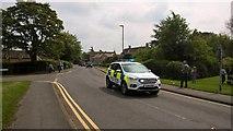 TF1505 : Police car on High Street, Glinton by Paul Bryan