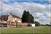 SP7715 : House on the A41 west of Aylesbury by David Howard