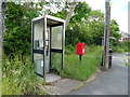 SJ3768 : Elizabeth II postbox and telephone box on Hermitage Road, Saughall by JThomas