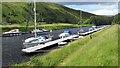 NN2896 : Boats tied up at Laggan Locks by Gordon Brown