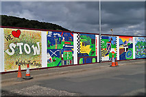 NT4935 : Colourful site hoarding at Huddersfield Street, Galashiels by Walter Baxter