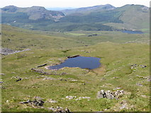 SH6052 : Small lake on Allt Maenderyn by Gareth James