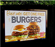 ST3091 : Flaming Grill burgers advert on an Almond Drive fence, Malpas, Newport by Jaggery