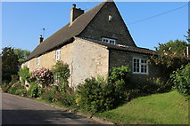 SP9693 : Cottage in Bulwick by David Howard