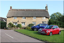 SP9694 : Thatched cottage in Bulwick by David Howard