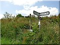 SE7624 : Footpath and road direction signs at Sand Hall by Graham Hogg