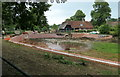 TQ6723 : Rebuilding the pond wall by Peter Jeffery