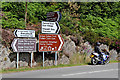 SN9164 : Road signs with biker near Elan Village, Powys by Roger  Kidd