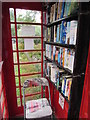 SO0725 : Chair and books inside a former red phonebox, Llanfrynach  by Jaggery