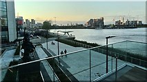 TQ3979 : View over the river towards Poplar from The Tide by Robert Lamb