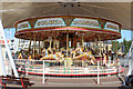 SD3317 : Carousel at the Start of Southport Pier by Chris Heaton
