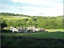 SE2425 : View from a Huddersfield-Leeds train - Houses near Howley Beck by Nigel Thompson