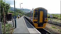 SH6214 : A train for Birmingham International departing from Morfa Mawddach station by John Lucas
