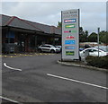 ST2986 : Mon Bank Retail Park businesses nameboard, Cardiff Road, Newport by Jaggery