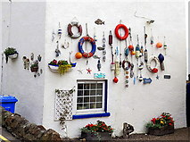 NO4202 : Maritime decor, Main Street, Lower Largo by Andrew Curtis