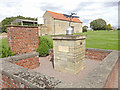 TF0078 : Airfield memorial at Dunholme Lodge by Adrian S Pye