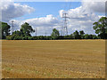 TL5062 : Stubble and pylons in early September by John Sutton