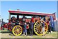 SJ4313 : Shrewsbury Steam Rally - putting the belt on by Chris Allen