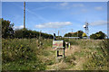 NZ2247 : Overgrown, derelict enclosure by Trevor Littlewood