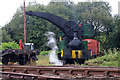 SJ9744 : Foxfield Railway - crane tank preparing to lift by Chris Allen