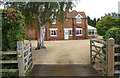SK8933 : Entrance to farmhouse at Echo Farm by Phil Richards