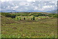 NH1804 : View south west over moorland and forestry by Nigel Brown