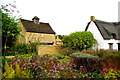TF1205 : Dovecote and garden at Clare Cottage by Tiger