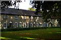 TM0458 : Stowmarket: almshouses along the churchyard by Christopher Hilton