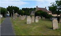SK9324 : Gravestones at St John the Baptist church by Mat Fascione