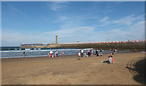 NZ8911 : West pier of harbour seen from Whitby Sands by habiloid