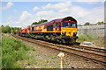 SE3693 : Freight train heading south on Northallerton station avoiding line by Roger Templeman
