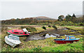 NN0801 : Small boats at the shore of Strachur Bay by Trevor Littlewood